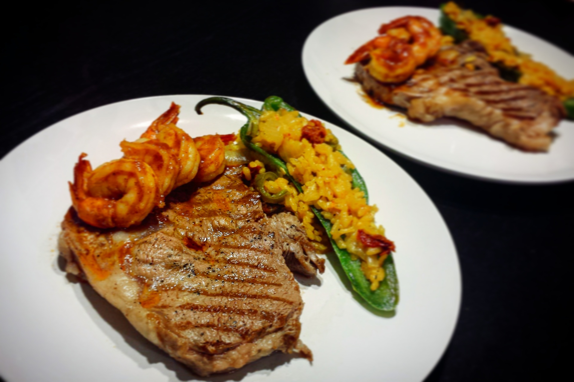 surf and turf with risotto stuffed chili