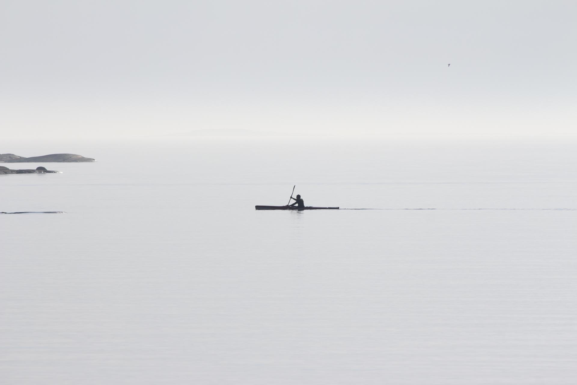 Minimalistic , kayaking on the sea , fog