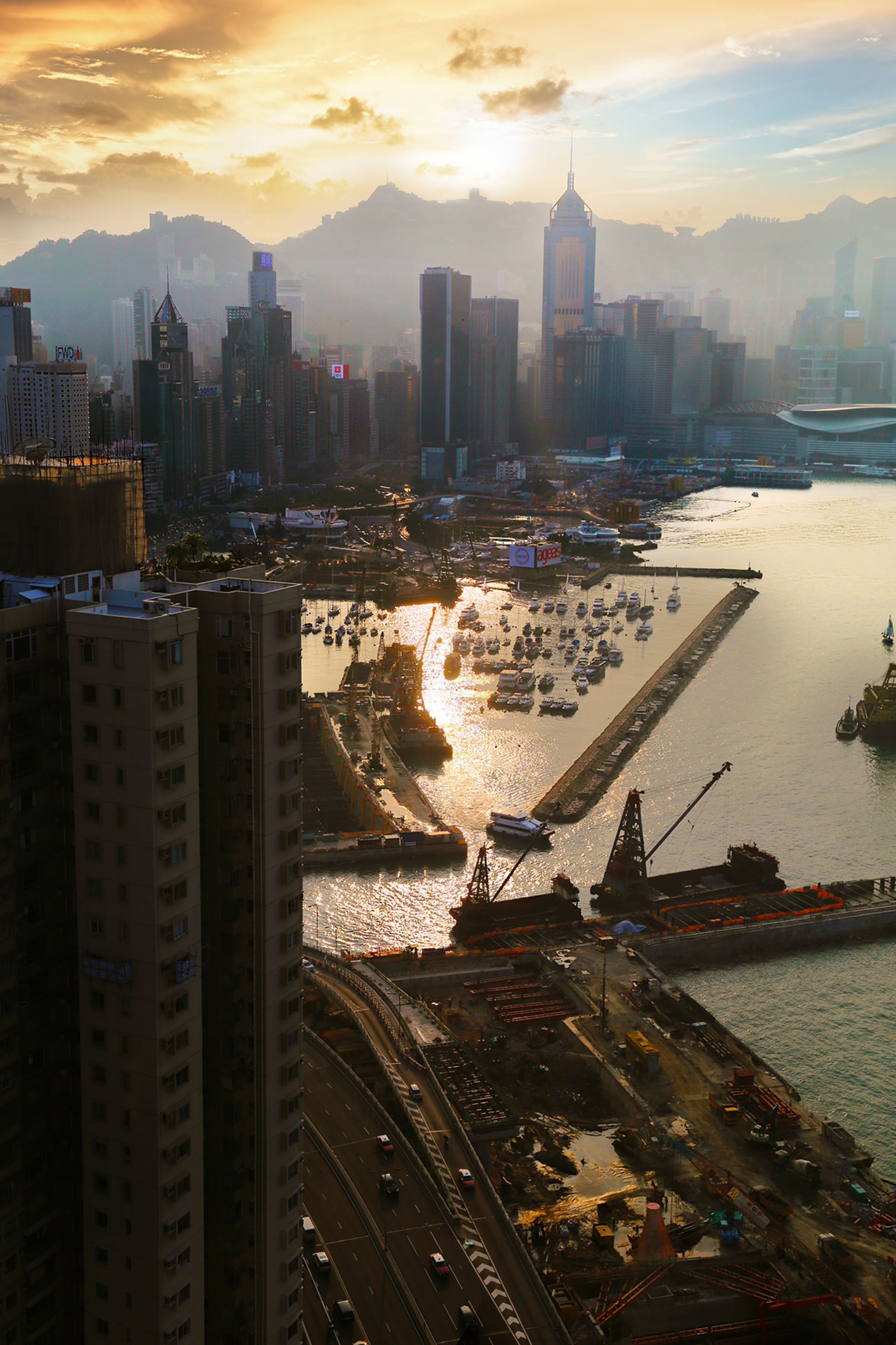 Causeway Bay under construction . Land reclamation and construction of a new highway from Quarry Bay to Central