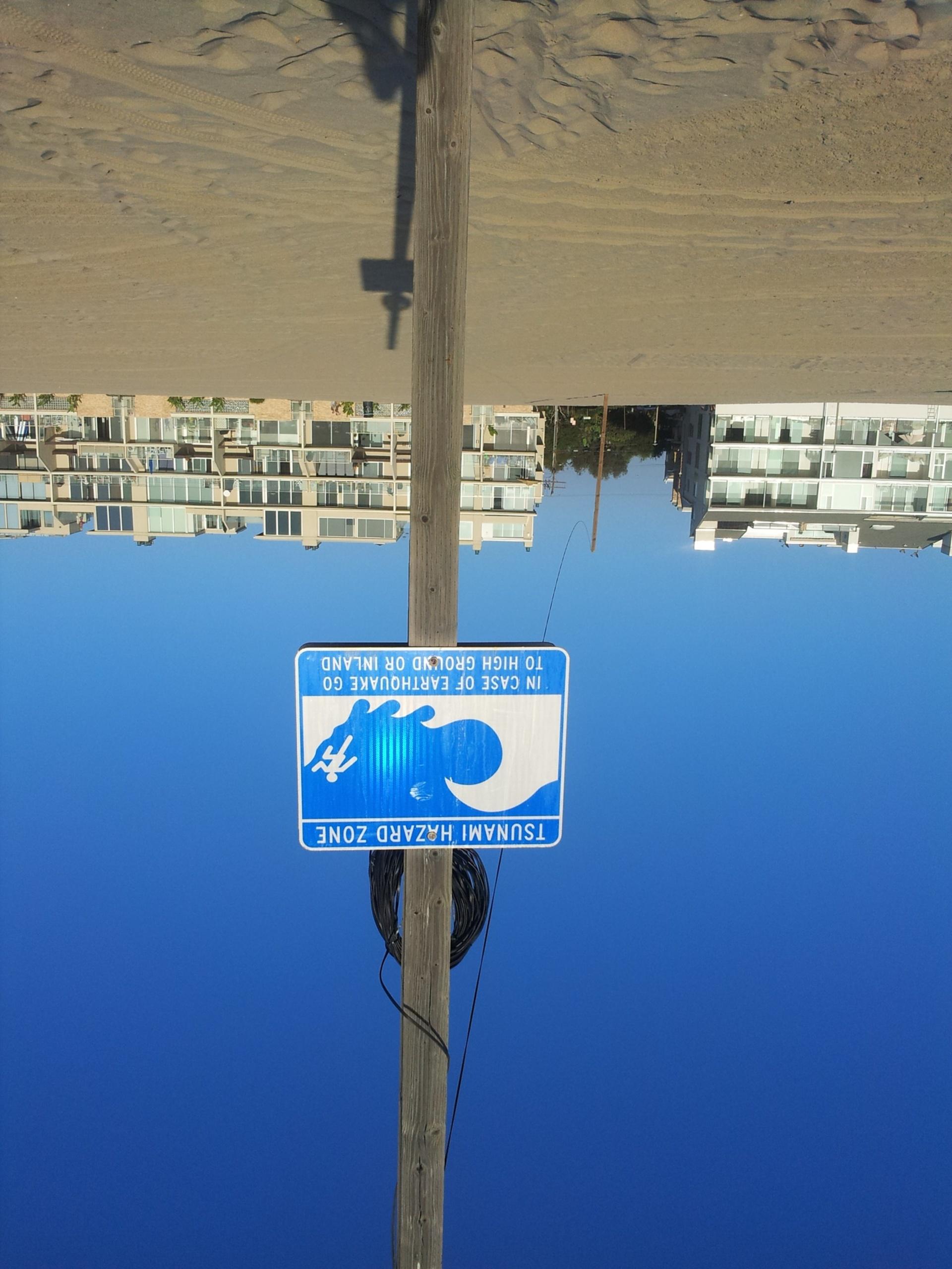 Tsunami hazard sign at beach