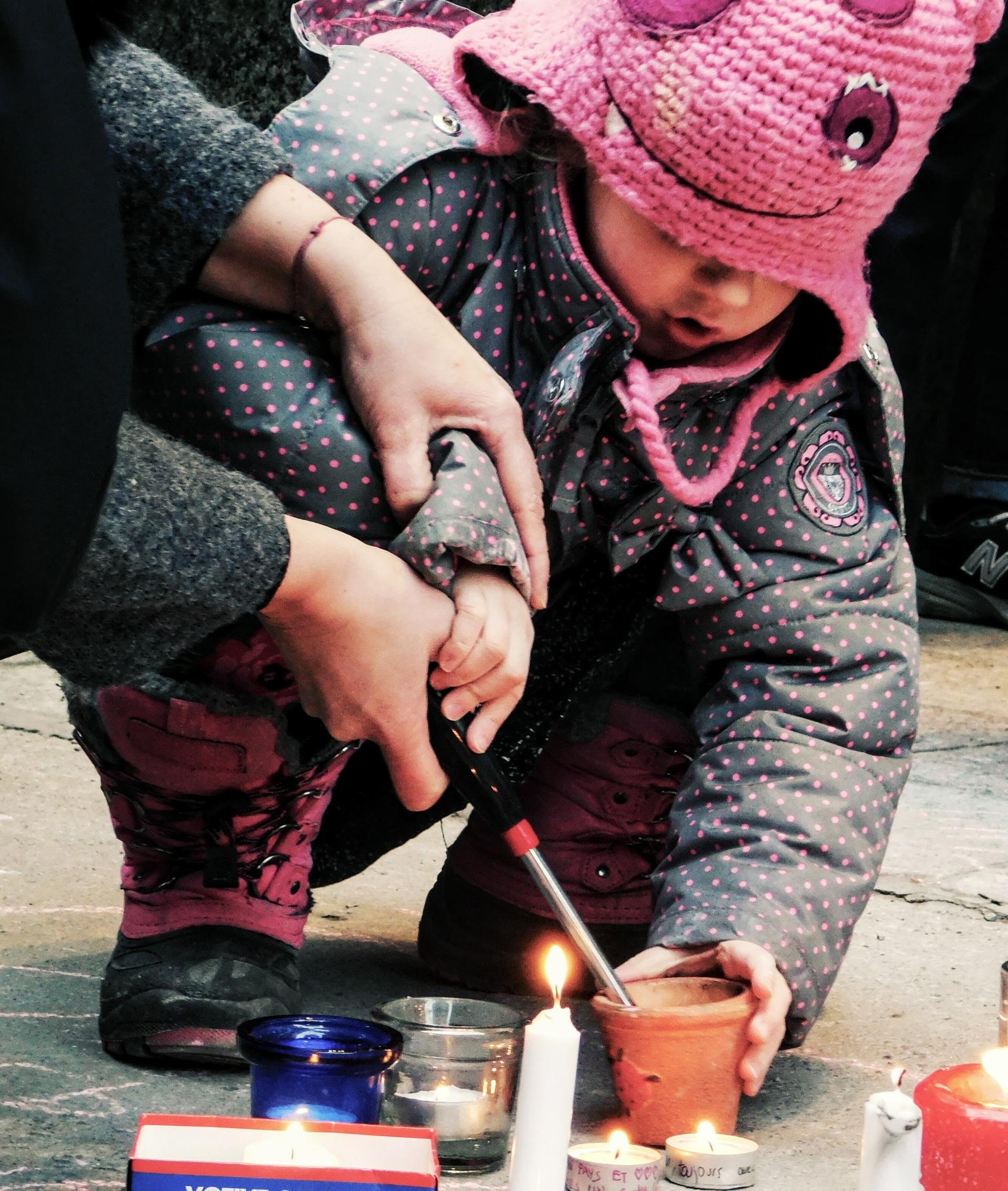 Kid lighting vigil candel | rick.cognyl.fournier, child, outdoors, people