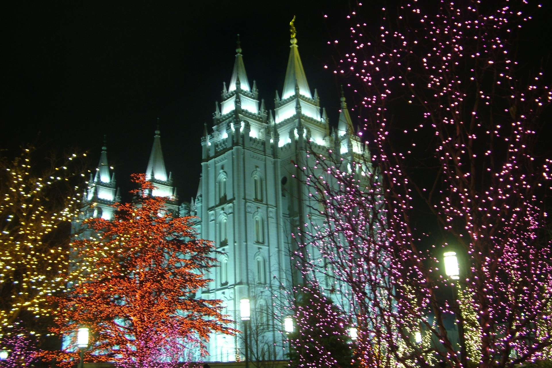 Salt Lake City, Utah LDS Temple at night during Christmas and filled with lights