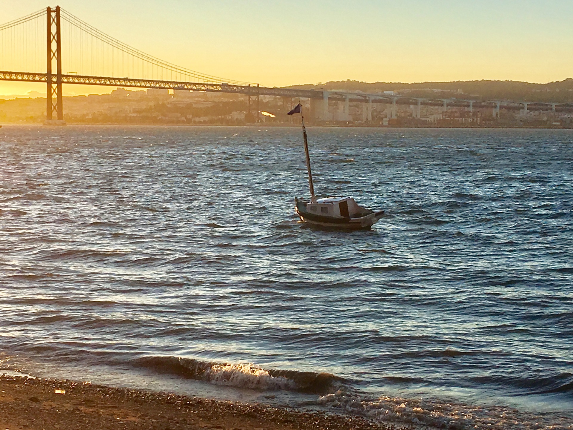 Little boat, big bridge