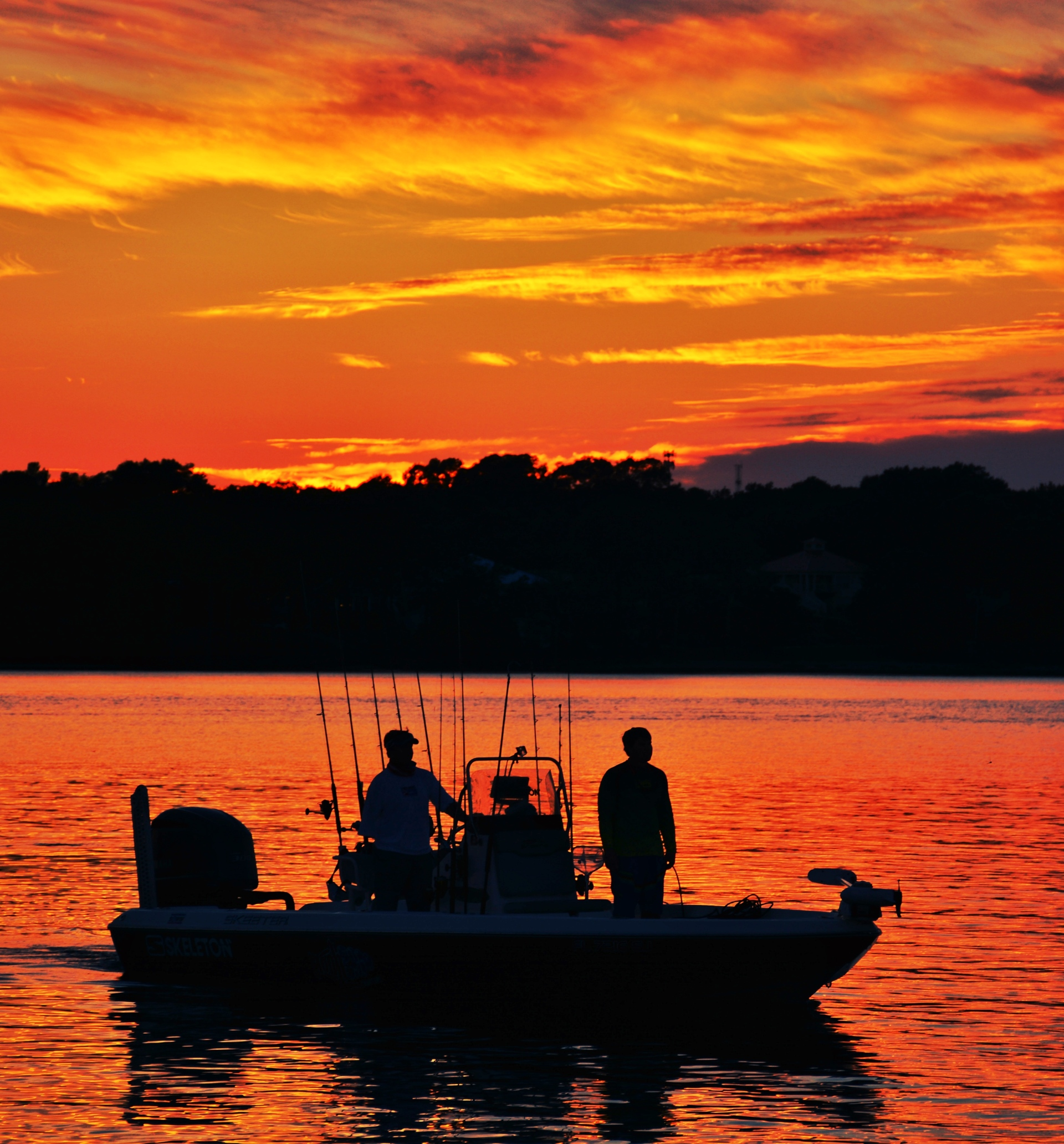 Fishermen return to the dock after a day fishing on the bay! Alluring Sunsets! Like the meeting of two worlds - the known and the unknown. The sun is like a great big romantic, inspirational fire in the sky. Brilliant streaks of yellow, orange, gold, blue, pink and red overcome the blue and purple of the sky. The sky resembled a prism; all the colors blended perfectly together. It's as if the colors and intensity of the light is just enough to calm you. The brilliant orb of amber and tangerine sunk lower and lower in the sky until it dipped down into the horizon. My work is done for today. I'm not sure what tomorrow will bring, but I'll be prepared for it!